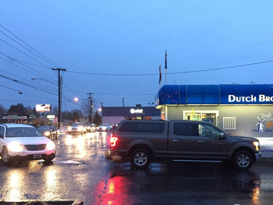 A line forms outside the Dutch Bros. location on Lancaster.