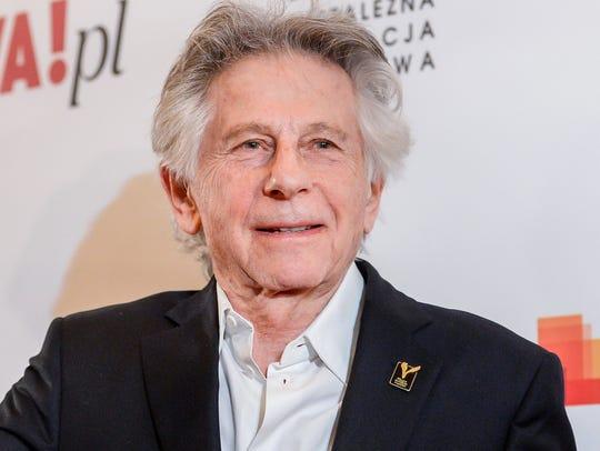 Director Roman Polanski poses with an award he received