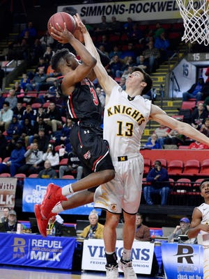 McQuaid's Josh Purcell, right, defends against Half Hollow Hills East's Savion Lewis during a Class AA semifinal at the 2018 NYSPHSAA Boys Basketball Championships, Saturday, March 17, 2018, in Binghamton, N.Y. McQuaid's season ended with an 82-66 loss to Half Hollow Hills East-XI.