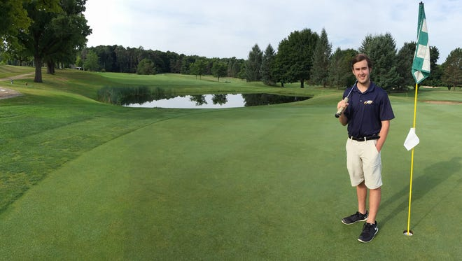 Hartland 2016 graduate Brendan Ludwig, posed at the ninth hole at Dunham Hills Golf Club, is the boys' Golf Athlete of the Year.