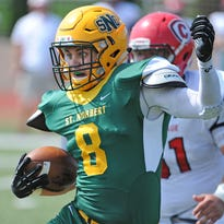 St. Norbert College defensive back Frank Laterza (8) runs back an interception against Carthage College at Schneider Stadium in De Pere on Sept. 5, 2015. Laterza leads the Green Knights with three interceptions this year.