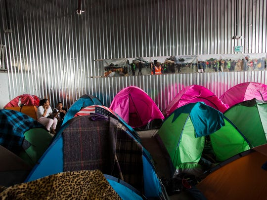 Migrants from Central America and Mexico live in tents