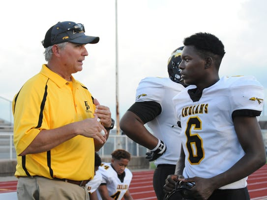 Fair Park head coach Mike Greene talks to Vashavien