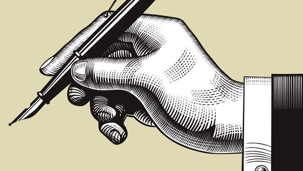 Vintage engraving drawing of hand with a pen. Vector illustration.