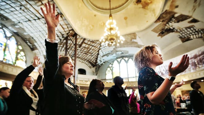 Congregation members of Downtown Church attend their first Sunday service at the historic Clayborn Temple  in downtown Memphis. The nonprofit Neighborhood Preservation Inc. has begun rennovation of the church, which was at the center of the sanitation worker strikes of 1968 and the site of several speeches by Dr. Martin Luther King Jr.