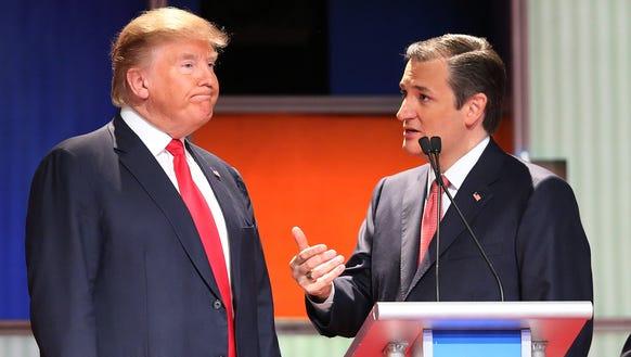 Donald Trump and Ted Cruz, speak at a debate in North