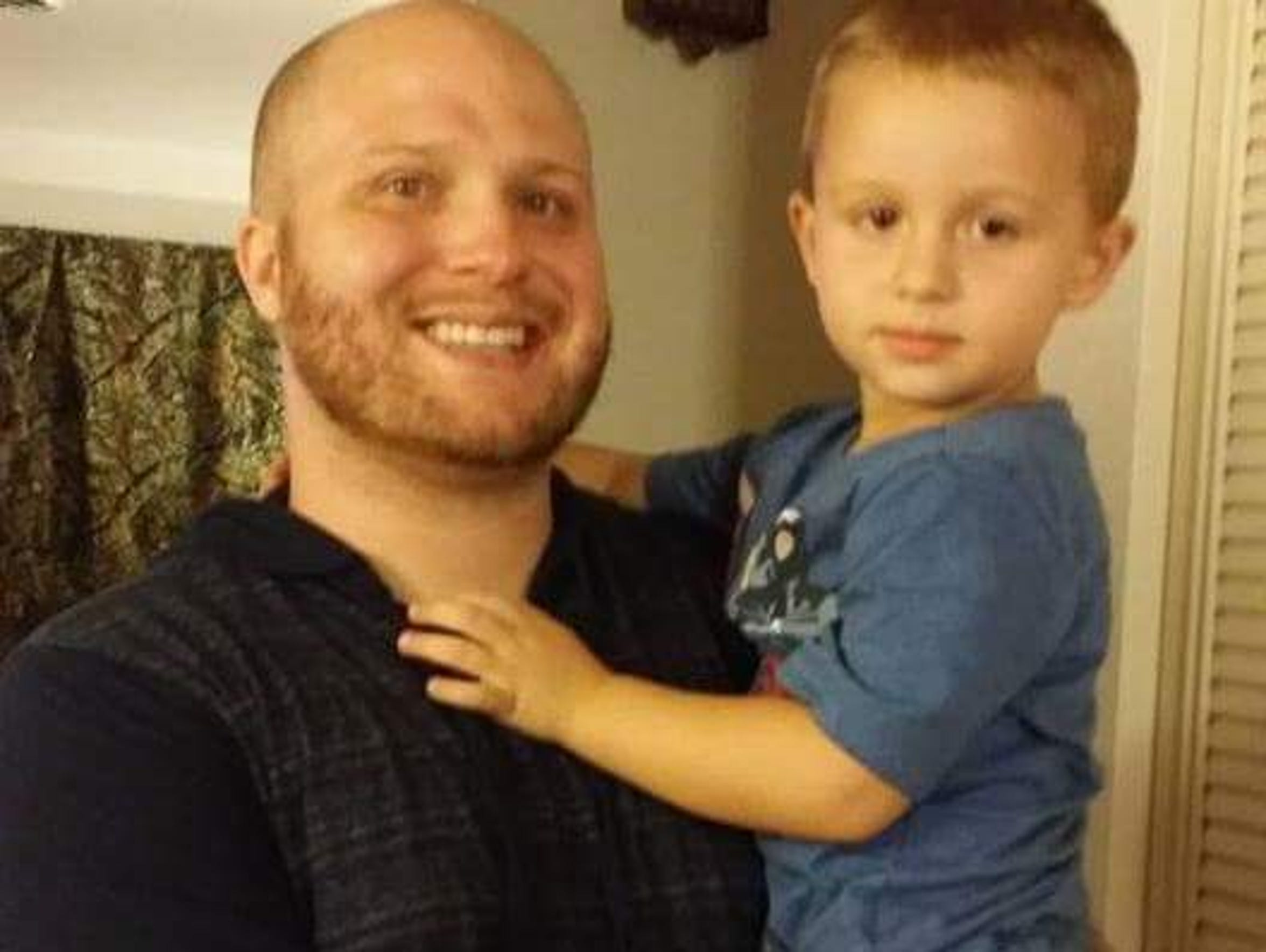 Chase Guysinger holds his son Conner David Guysinger.