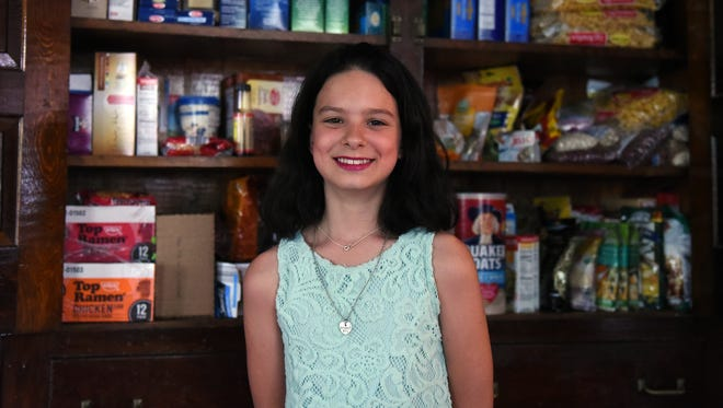 """Jasmine Stroh, of Pataskala, is raising money to build cabinets to be filled with canned and other non-perishable food items, called """"blessing boxes,"""" to be placed around Pataskala. The project is inspired by one of the Torah passages Stroh selected for her August bat mitzvah."""