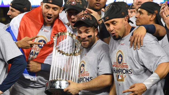 American League MVP Jose Altuve, center, was one of the main reasons the Houston Astros took home the 2017 World Series trophy.
