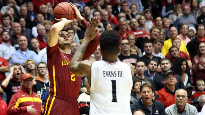 Iowa State forward Abdel Nader (2) makes a three point basket against Cincinnati Bearcats forward Jacob Evans (1) in the second half at Fifth Third Arena. Iowa State won 81-79. Mandatory Credit: