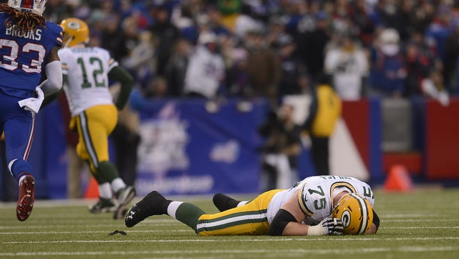 Green Bay Packers tackle Bryan Bulaga lays on the ground after getting injured during Sunday's game against the Buffalo Bills at Ralph Wilson Stadium in Orchard Park, N.Y.