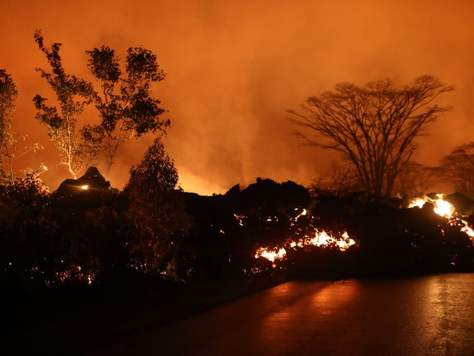 Lava from a Kilauea volcano fissure advances on a roadway