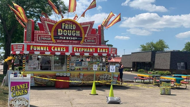 In June, CDAC, Inc. Amusements from Peoria, began to place funnel cake stands in American Legion parking lots, including this one in Dunlap. The carnival company has long provided carnivals and concessions for Kewanee Hog Days. Next week, the Hog Days committee will meet and could decide the fate of this year's festival.