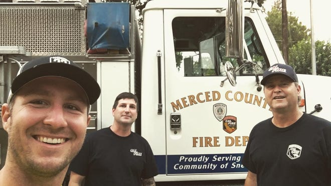Augusta native and Air Force veteran Eben Engler (left) is riding his bike from San Francisco, Calif. to Charleston, SC to raise awareness for veteran suicide. Along the way he stopped in Snelling, Calif. where he met members of the local fire department who helped him find a campsite to stay for the night and provided water and a shower for him.