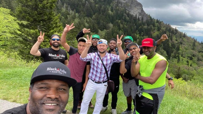 Earl Hunter and a group of friends enjoy the mountains.