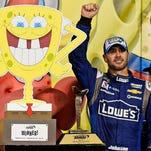 May 9, 2015; Kansas City, KS, USA; NASCAR Sprint Cup Series driver Jimmie Johnson celebrates after winning the Spongebob Squarepants 400 at Kansas Speedway. Mandatory Credit: Jasen Vinlove-USA TODAY Sports