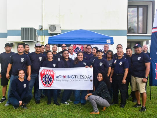 To mark Giving Tuesday, personnel from Guam Fire Department's 911 emergency communication and others handed out pancakes and good will in Hagåtña Tuesday morning, Nov. 29, 2016.