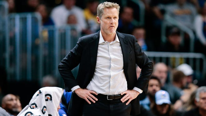 Golden State Warriors head coach Steve Kerr looks on in the second quarter against the Denver Nuggets at the Pepsi Center.