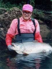 "Howard ""Rip"" Collins displays the Arkansas state record 40.4-pound brown trout he caught on the Little Red River in 1992."