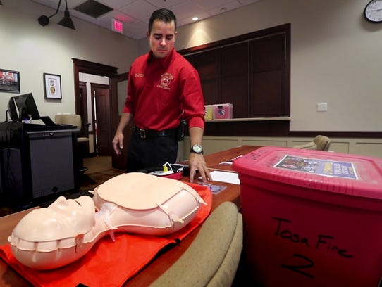 Division Chief Chris Sandoval with a CPR training kit