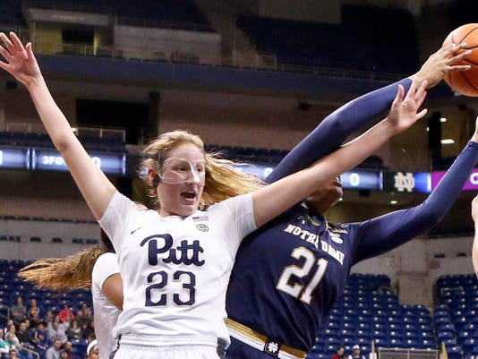 Pittsburgh's Alayna Gribble (23) and Notre Dame's Kristina Nelson (21) reach for a rebound during the first half of an NCAA college basketball game, Thursday, Jan. 25, 2018, in Pittsburgh. (AP Photo/Keith Srakocic)