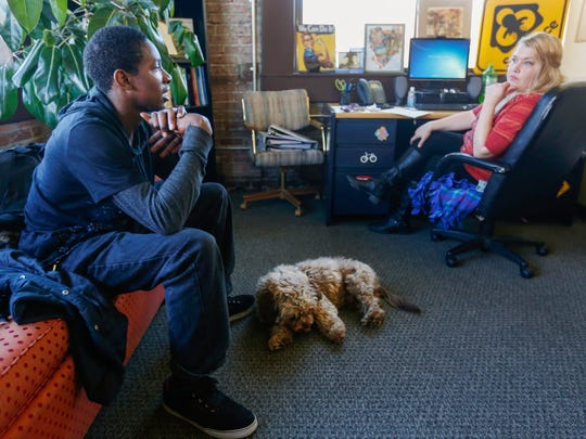 De'Kiah Rose, left, talks with Shannon Adam at Rare Breed on Wednesday, Feb. 22, 2017 about housing and school as his dog CoCo lays next to him.
