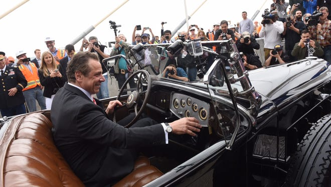 Governor Andrew Cuomo drove a 1932 Packard owned by Franklin Delano Roosevelt during the opening of the first span of the Kosciuszko Bridge in New York City on April 27, 2017. But the same grand celebration is not planned for the opening of the first span of the new Tappan Zee Bridge on Aug. 25, 2017.