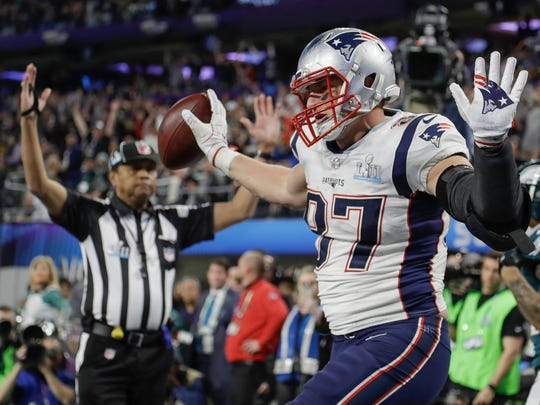 New England Patriots tight end Rob Gronkowski (87) dances as he celebrates a touchdown reception, during the second half of the NFL Super Bowl 52 football game against the Philadelphia Eagles, Sunday, Feb. 4, 2018, in Minneapolis.