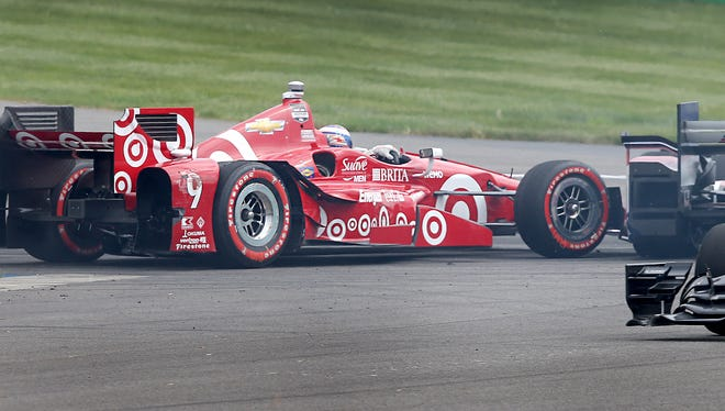 Scott Dixon's car got turned around in Turn 1 of the Angie's List Grand Prix of Indianapolis by Helio Castroneves
