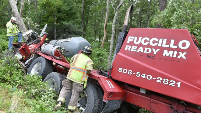 West Barnstable fire crews survey the scene of a single-vehicle accident off the eastbound lane of Route 6 between exits 4 and 5 Tuesday afternoon. The driver of the vehicle, a cement truck, had to be extricated. To see video from the scene, go to capecodtimes.com/videos.