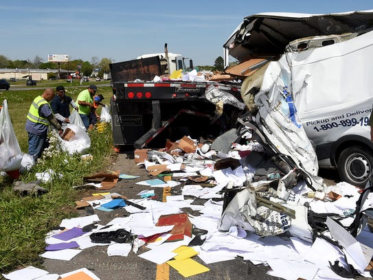 Crews clean up the aftermath of a crash on Interstate