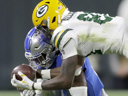 Tracy Walker hits Packers receiver Geronimo Allison on a pass play, Oct. 14 at Lambeau Field.