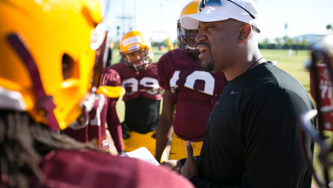 ASU assistant coach DelVaughn Alexander talks to his wide receivers during Spring practice at the Kajikawa practice fields at ASU  in Tempe on Thursday, April 3, 2014.