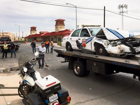 Aaron Martinez—El Paso Times An El Paso police vehicle sits atop a wrecker truck following a collision with another vehicle at Montana and Birch Streets in Central El Paso Wednesday.