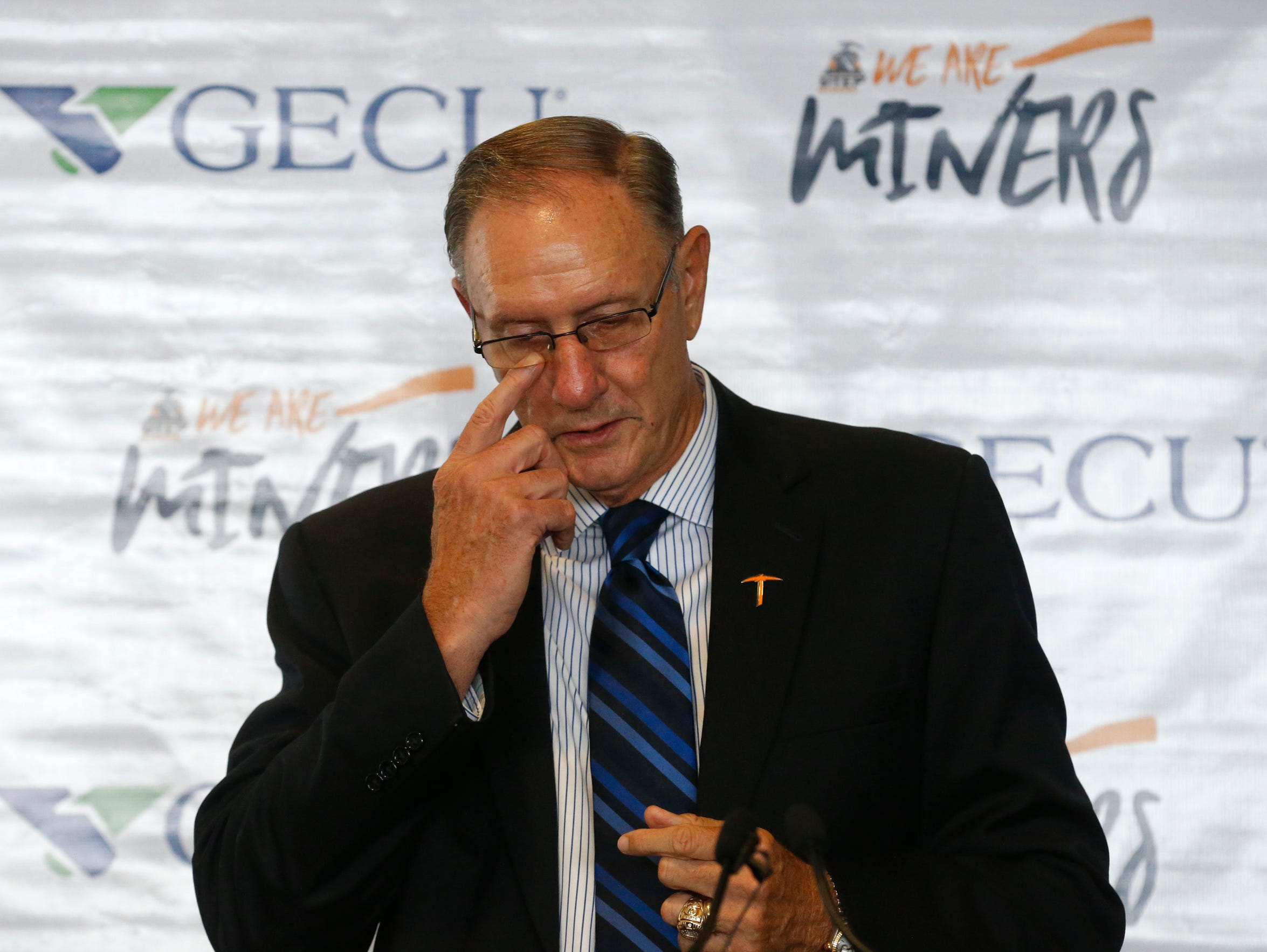 UTEP Athletic Director Bob Stull wipes a tear from his check as he addressed a small crowd of family, coaches friends and administrators as he officially announced his planned retirement.