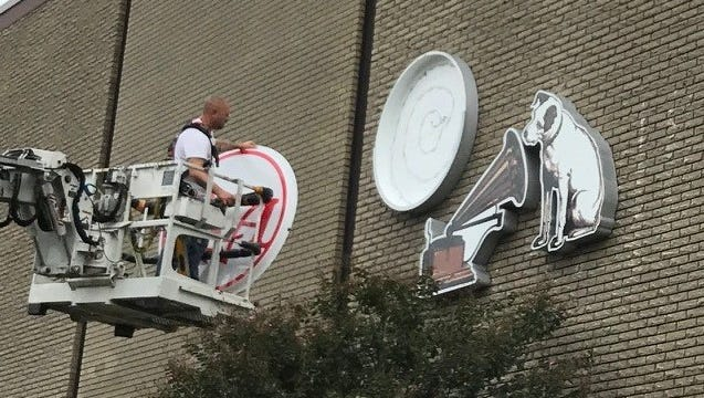 A worker mounts the iconic sign of Studio A on Saturday, Oct. 21, 2017, in Nashville.