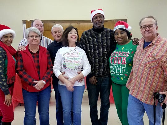 Event organizers from Sisters With Aspiring Goals, Northisde Assembly of God Church and C-MACC Sandra Higgins, Brenda Overton, Larry and Ricki Elk, Ella Watkins and Frank Poppelaars pose with Jackson City Councilman Ernest Brooks, II at the 10th annual Christmas Art Celebration presented by The American Art Academy and C-MACC ArtCare and Brainbow Creative Recovery.