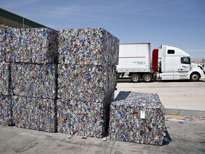 Bales of recycled aluminum cans awaits shipping outside