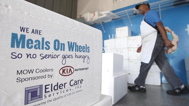 Hot and cold meals are boxed for the 'Big Wheels Deliver Meals' event where local community leaders are asked to help deliver food to the local elderly population.