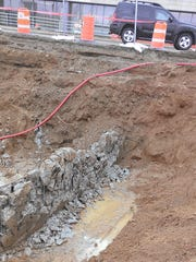 While building the foundation for CityDeck Landing apartments, workers did not expect to find the remains of other structures on the site, including a collapsed pedestrian tunnel, bridge abutments and an electrical vault. The construction site is at North Washington and Main streets in downtown Green Bay.