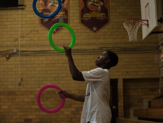 Duel Thompson juggles during a training session with