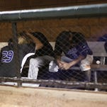Faulkner head coach Patrick McCarthy consoles pitcher Jack Charleston in the dugout after the Eagles' 10-8 loss to Lewis-Clark State, ending Faulkner's season at the NAIA World Series on Thursday night in Lewiston, Idaho. Faulkner's Junior Santos is seated next to Charleston.