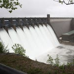 Water flows through the spillway gates at Table Rock Dam on Monday, April 25, 2011. The current water flow through the spillway is about 1/4 of what it was in 2011.