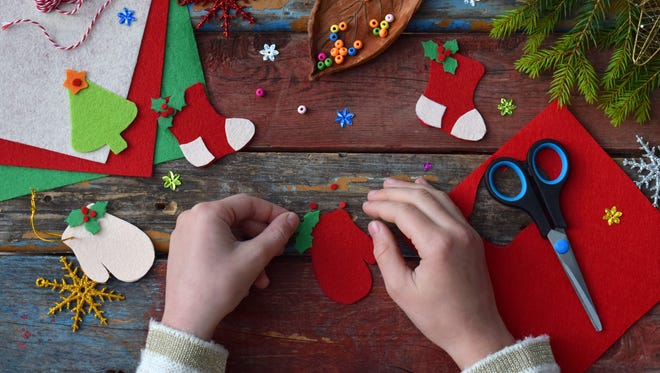 Felt is easy to work with, colorful and inexpensive -- a perfect base for kids' holiday crafts.