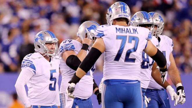 Lions kicker Matt Prater, left, celebrates his 56-yard field with lineman Brian Mihalik in the second quarter against the Giants at MetLife Stadium on Sept. 18, 2017 in East Rutherford, N.J.