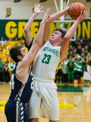 Floyd Central High School forward Luke Gohmann (23)