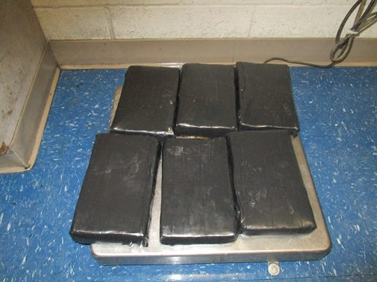 U.S. Customs and Border Protection officers seized more than 15 pounds of cocaine hidden in a vehicle's trunk Sunday at the Bridge of the Americas.