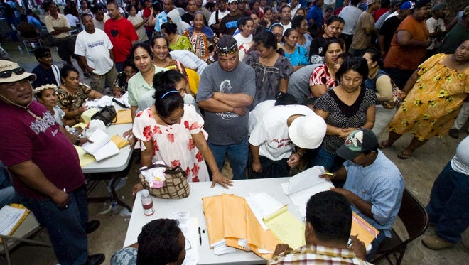 Thousands of Chuukese voters line up to cast their ballots for the Chuuk state general election at the Mangilao mayor's office in March 2009.