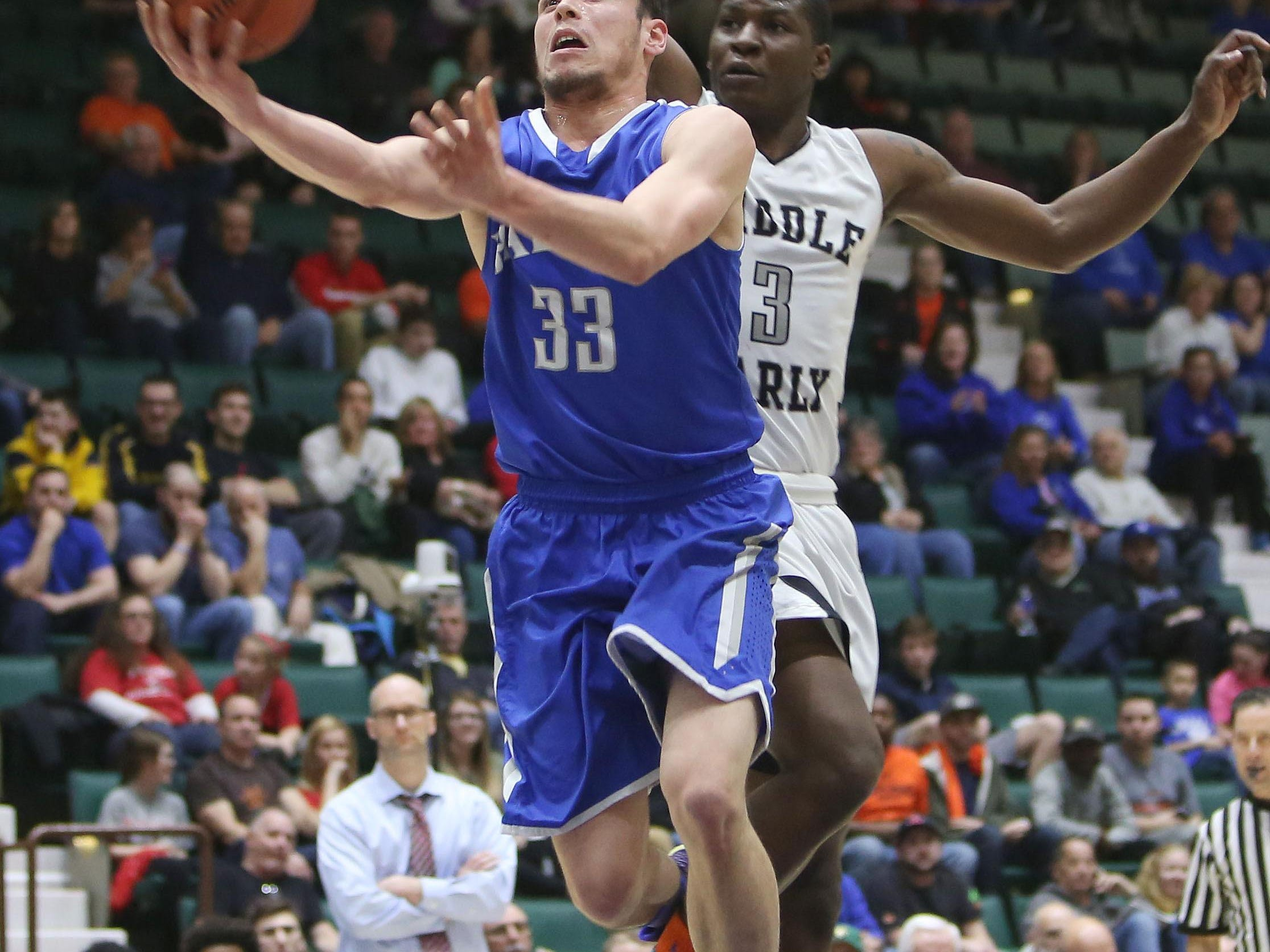 Haldane's Will Zuvic drives to the basket in front of Middle Early College's Gary Foster during the Class C state championship game at the Glens Falls Civic Center Saturday. Middle Early College won the game 82-40.