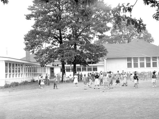 Children play during Pringle Elementary School's centennial celebration in 1956.